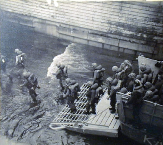 "Marine infantry transfers from ""Mike"" boats to Amtracs in the well deck...1958"